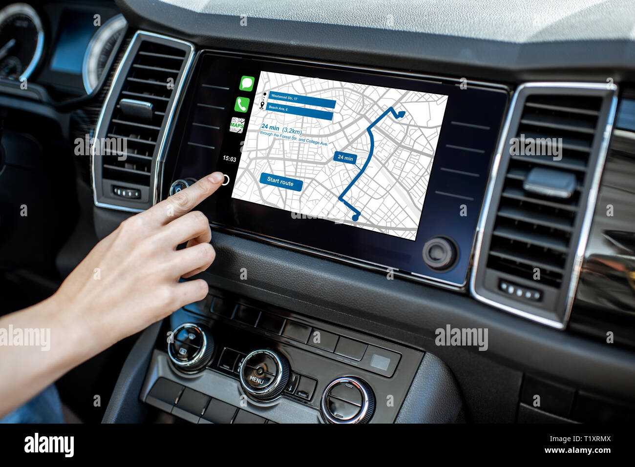 Touching a monitor with navigation map of the modern car, close-up view - Stock Image