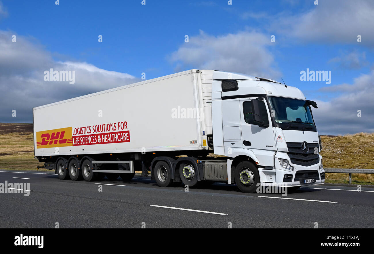 DHL LOGISTICS SOLUTIONS FOR LIFE SCIENCES & HEALTHCARE Mercedes-Benz Actross HGV. M6 Motorway, Southbound, Shap, Cumbria, England, United Kingdom. Stock Photo