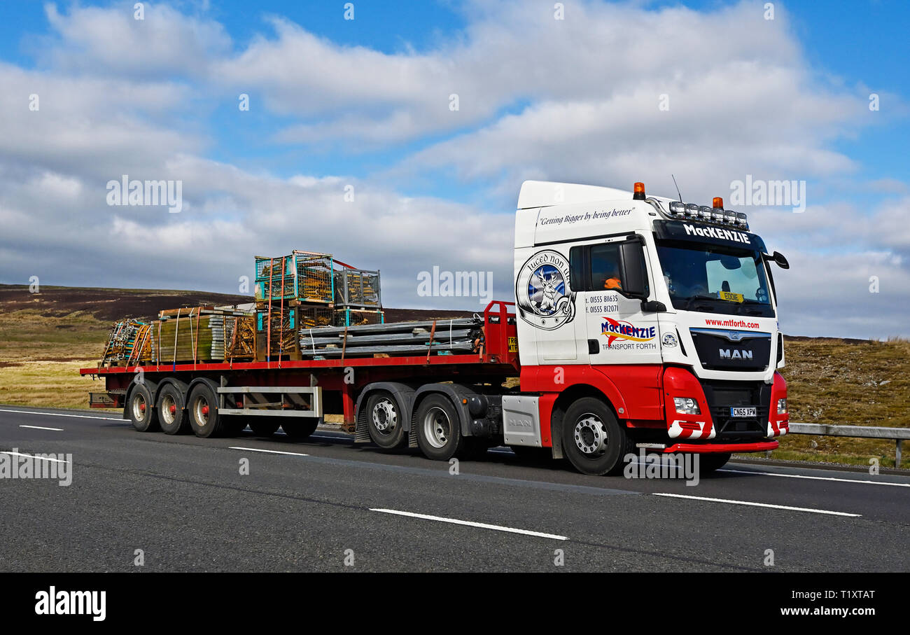 MacKenzie Transport Forth HGV with load of assorted building materials. M6 Motorway, Southbound, Shap, Cumbria, England, United Kingdom, Europe. Stock Photo