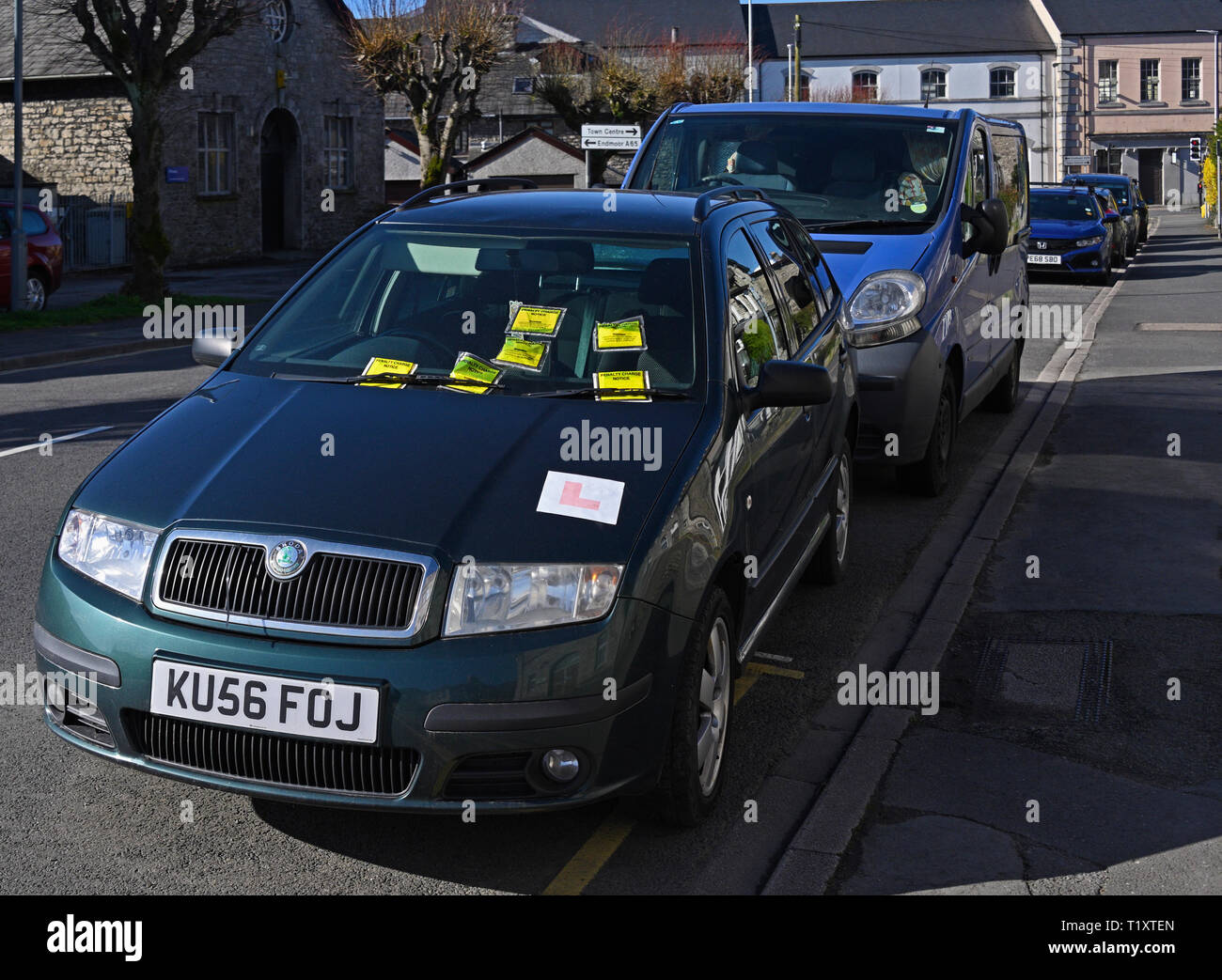 Illegally parked car on yellow line with six penalty charge notices. Parkside Road, Kendal, Cumbria, England, United Kingdom, Europe. - Stock Image