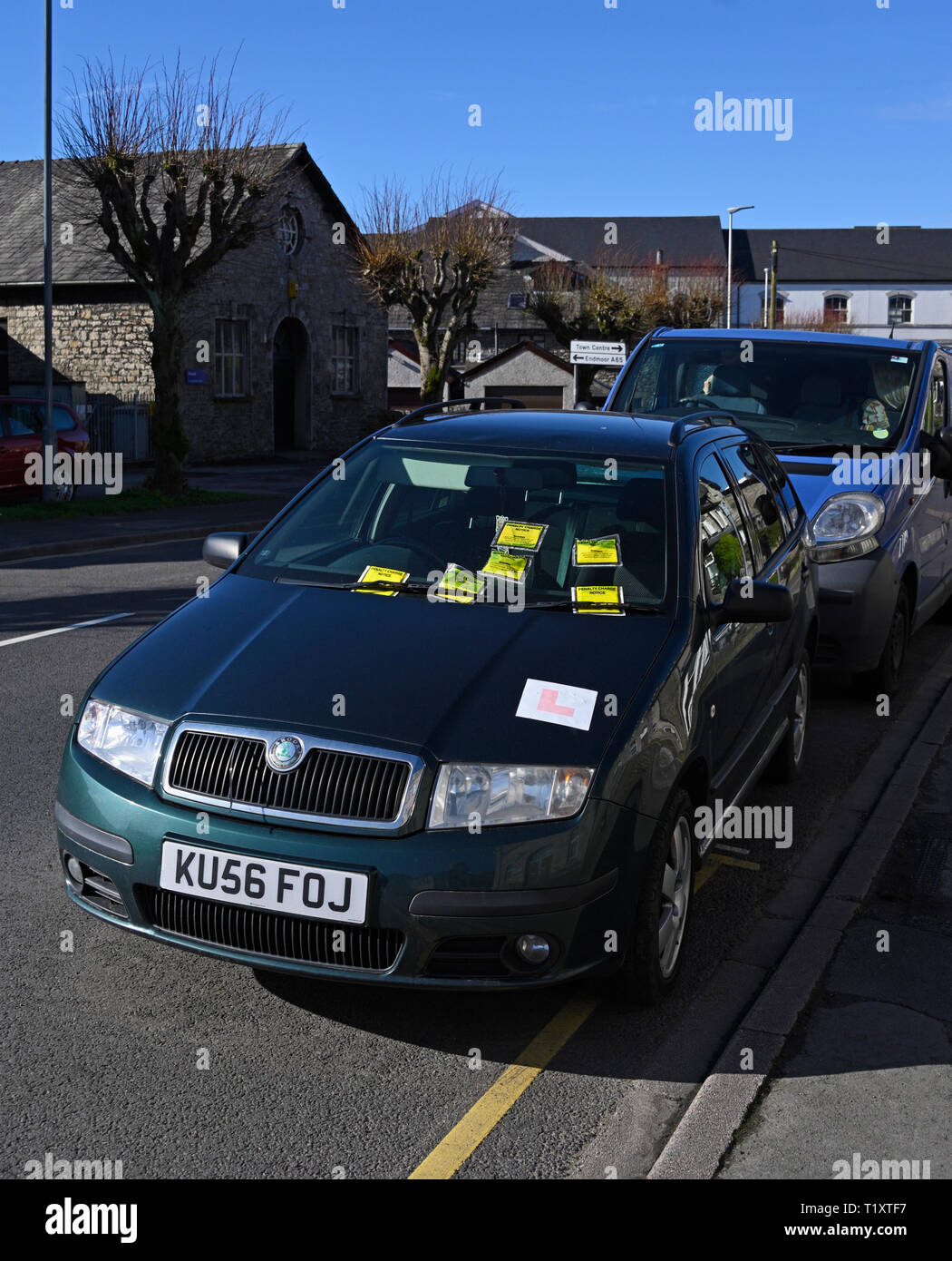 Illegally parked car on yellow line with six penalty charge notices. Parkside Road, Kendal, Cumbria, England, United Kingdom, Europe. Stock Photo