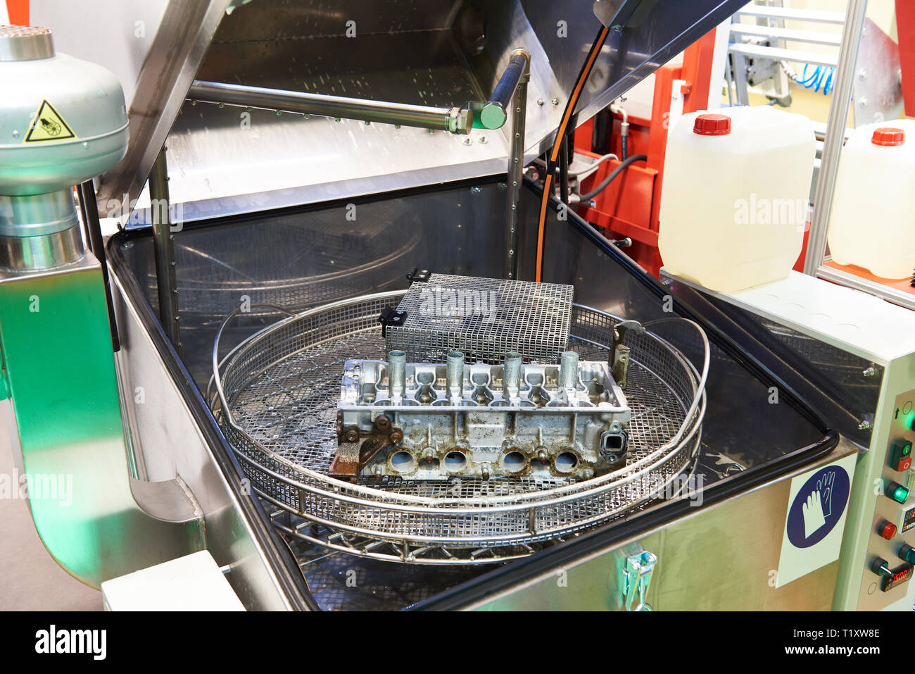 Automatic washing system for engine parts and assemblies - Stock Image