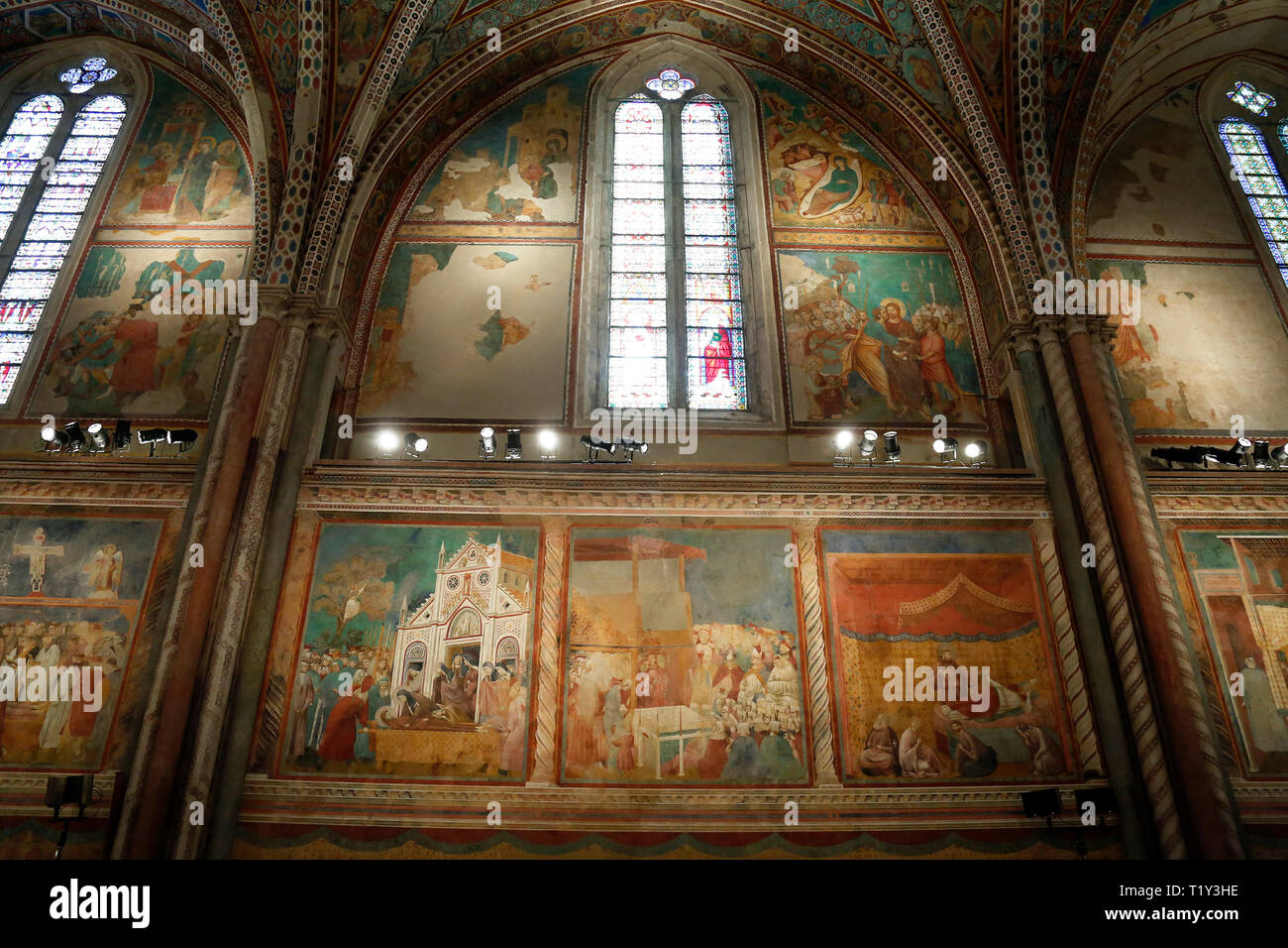 The upper basilica, frescoed by Cimabue Assisi March 29th 2019. The Basilica of Saint Francis of Assisi. On 16 July 1228, st Francis was canonized by  - Stock Image