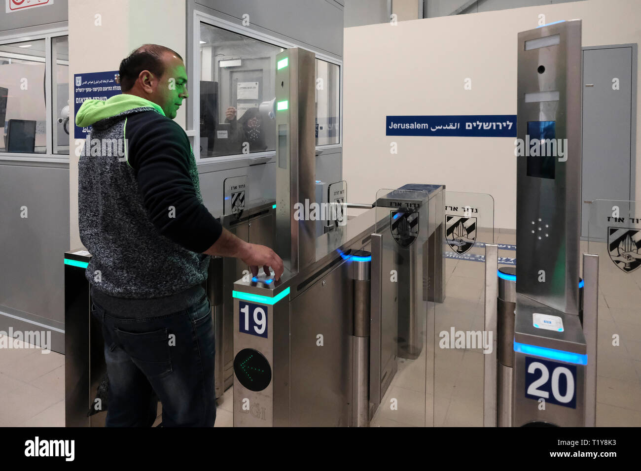 Qalandya, ISRAEL 28th March - A Palestinian man on his way to Jerusalem crossing turnstile gate with bio-metric system at the newly renovated Kalandia or Qalandiya Checkpoint between Jerusalem and Ramallah on 28 March 2019. The Qalandiya Checkpoint's $11 million renovation was carried out in order to enhance the commute of thousands of Palestinians every day, mostly with the help of new identification stations with improved technology. Credit: Eddie Gerald/Alamy Live News - Stock Image
