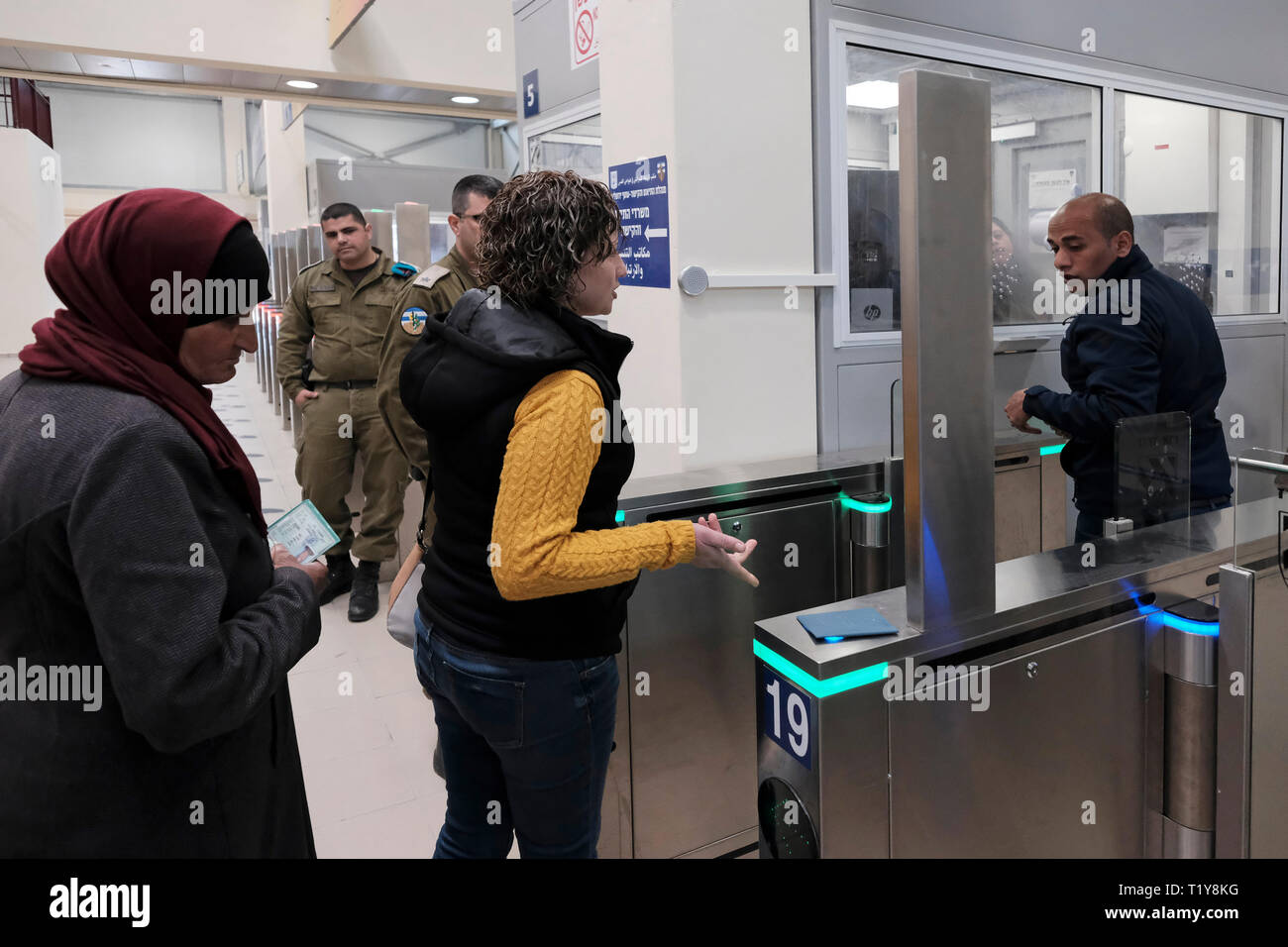 Qalandya, ISRAEL 28th March - Palestinians on their way to Jerusalem crossing turnstile gate with bio-metric system at the newly renovated Kalandia or Qalandiya Checkpoint between Jerusalem and Ramallah on 28 March 2019. The Qalandiya Checkpoint's $11 million renovation was carried out in order to enhance the commute of thousands of Palestinians every day, mostly with the help of new identification stations with improved technology. Credit: Eddie Gerald/Alamy Live News - Stock Image