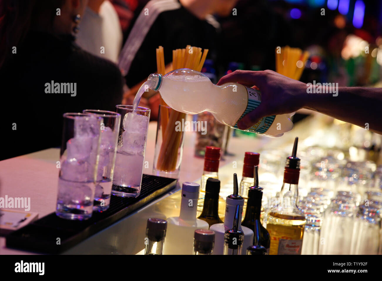 Berlin, Germany. 28th Mar, 2019. Drinks are mixed at the bar. The launch of Lidl's 'Esmara x Influencer' collection at the Arena Berlin was a celebration. Credit: Gerald Matzka/dpa-Zentralbild/ZB/dpa/Alamy Live News - Stock Image