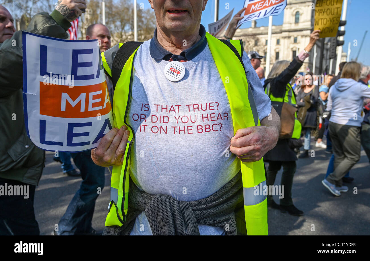 London, UK. 29th Mar, 2019. Pro Brexit protester wearing anti media shirt as they block streets around Parliament Square London today as they show their anger at not leaving the EU today causing traffic chaos in the city . MP's are sitting today to debate leaving the European Parliament on the day it was originally supposed to happen Credit: Simon Dack/Alamy Live News Stock Photo