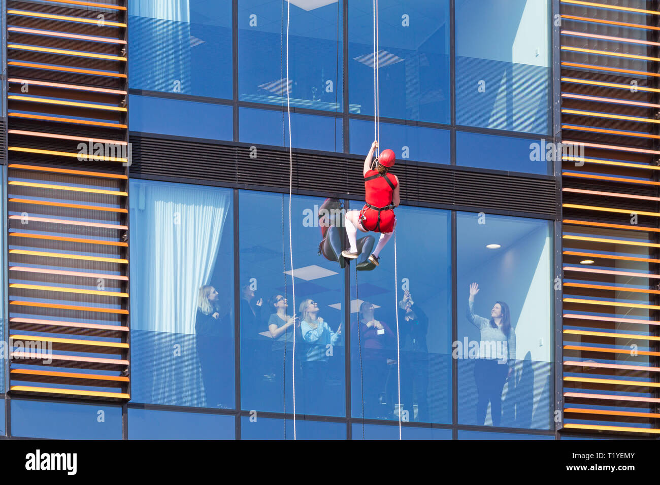 Bournemouth, Dorset, UK. 29th Mar, 2019. Staff working for telecommunications provider 4Com abseil down their new office building at One Lansdowne Plaza in Bournemouth which is 100ft high. They are raising funds for Hope Housing and Hope AOK Rucksack Appeal who provide support to homeless in Bournemouth. A lovely warm sunny day for the descent! Credit: Carolyn Jenkins/Alamy Live News - Stock Image