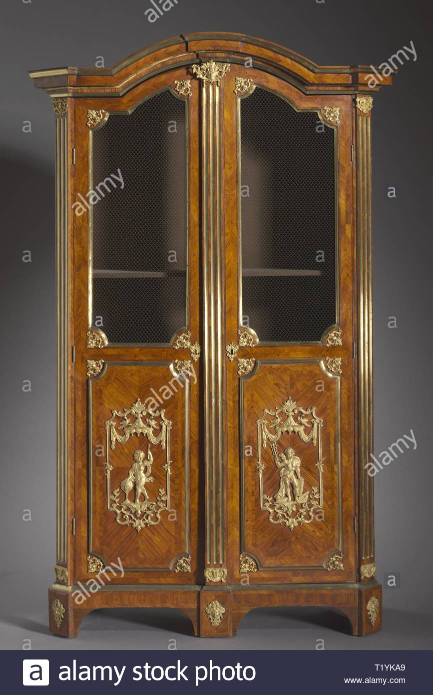 Bookcase , c. 1720. Attributed to Charles Cressent (French, 1685-1768). Kingwood and rosewood veneers, gilt metal mounts; overall: 247.6 x 132.1 x 57.2 cm (97 1/2 x 52 x 22 1/2 in.). - Stock Image