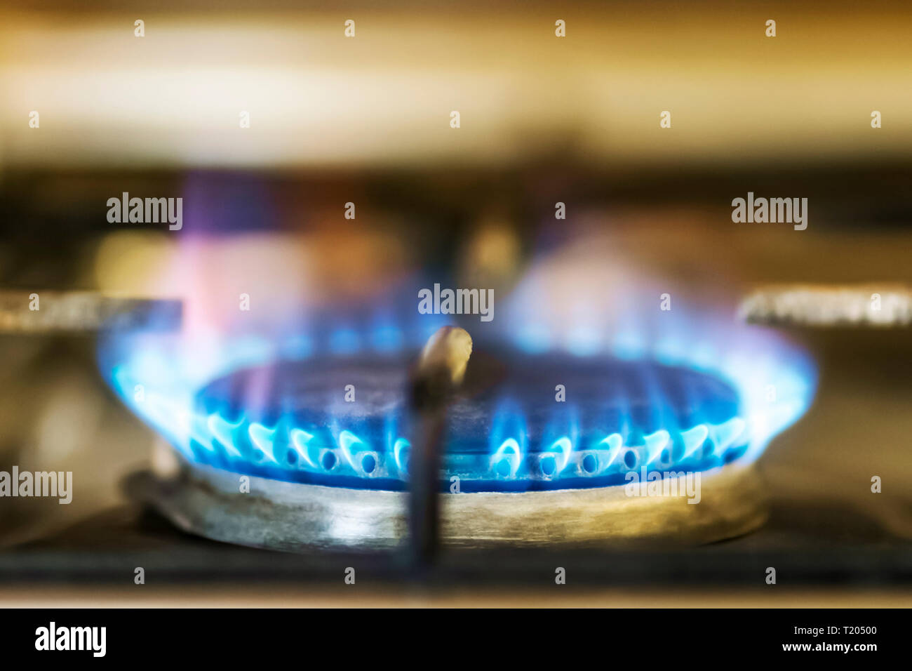 burning blue flame gas on the old stove in the kitchen - Stock Image