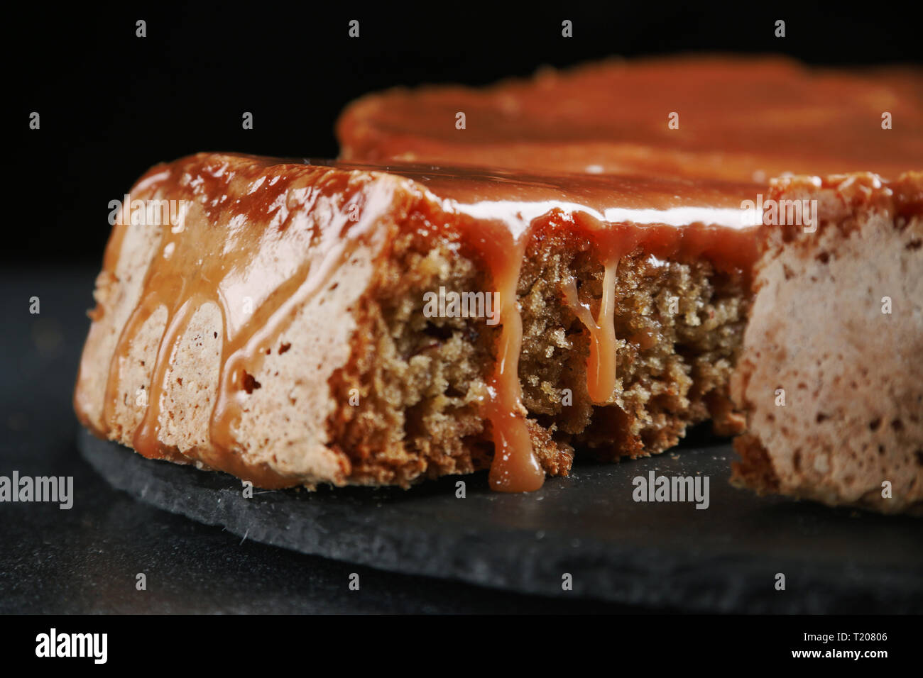 pie with caramel close up on dark background. cake with banana and caramel. Stock Photo