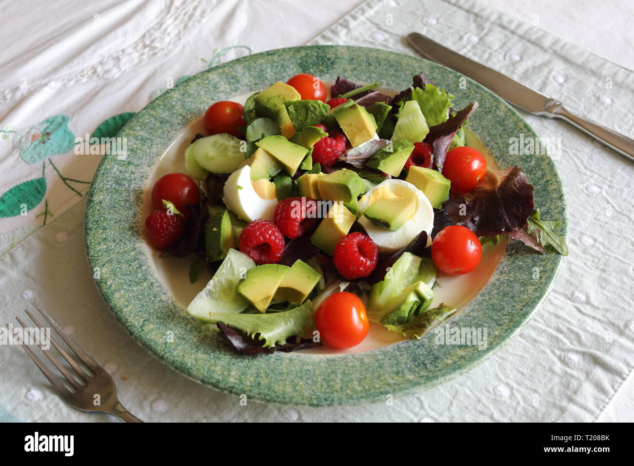 A Poole Pottery plate containing a healthy salad - Stock Image