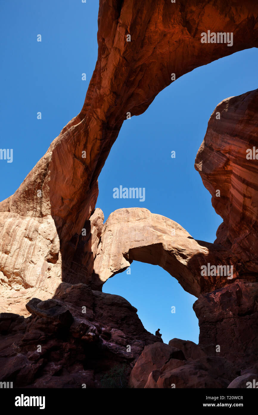 Tourist On Double Arch Arches National Park Utah America