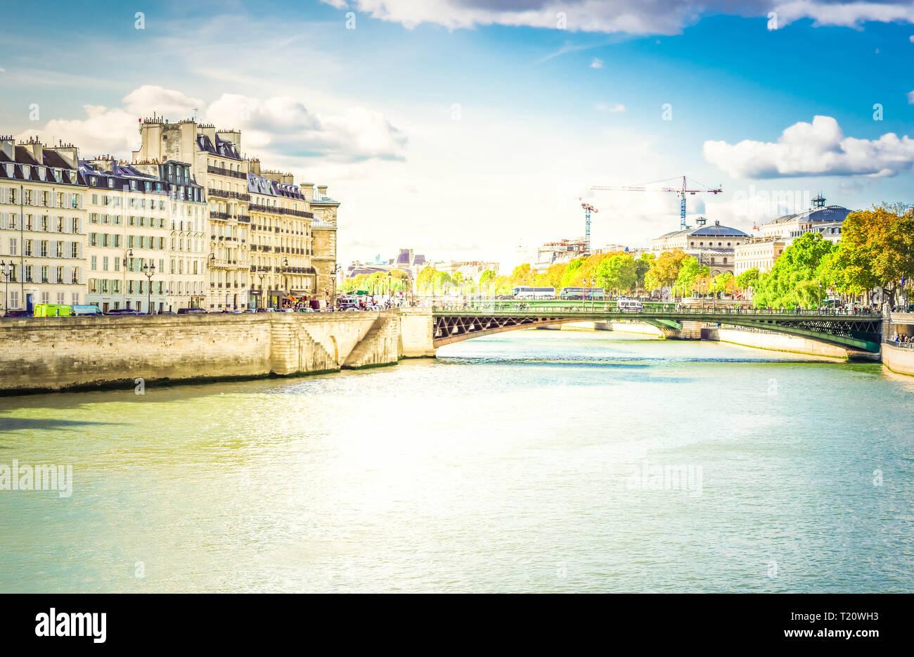 Pont au Double bridge and island Cite, blue sky with clouds, Paris, France, toned - Stock Image