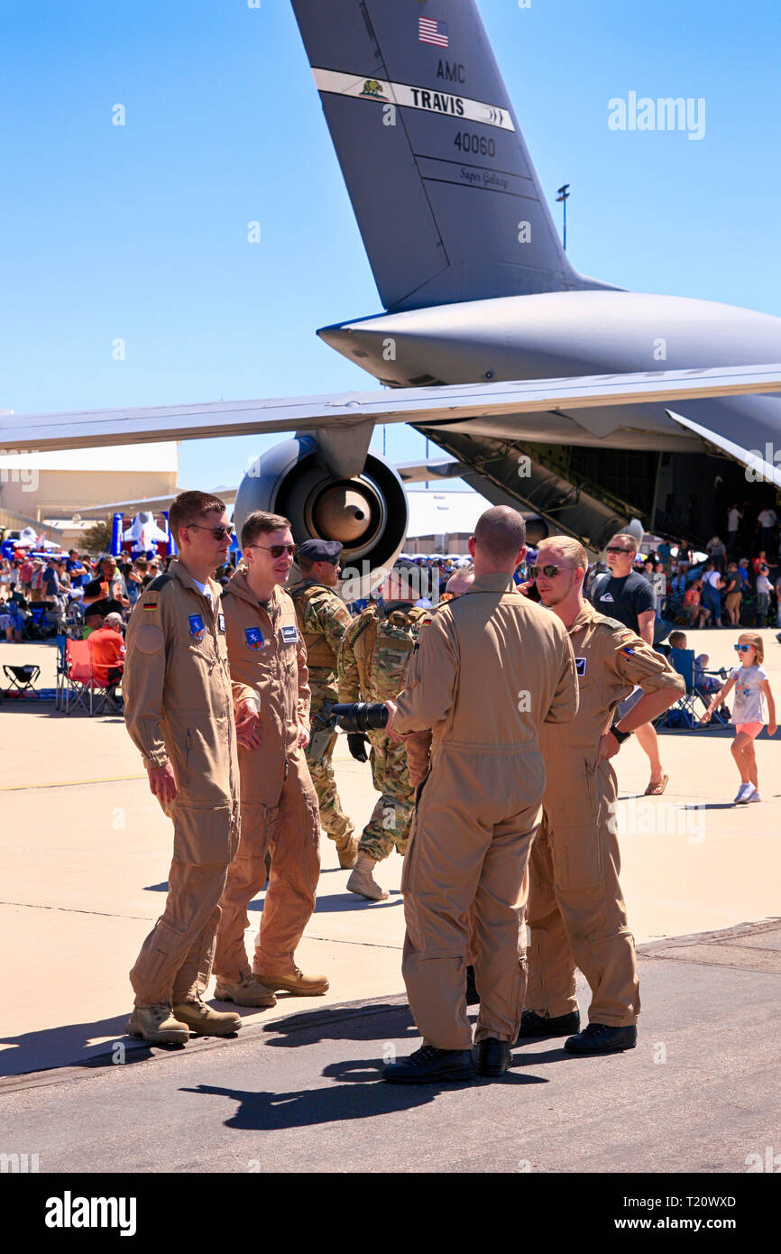 Military flight crewmembers swap stories of their flying exploitsat the Davis-Monthan AFB airshow in Tucson AZ - Stock Image