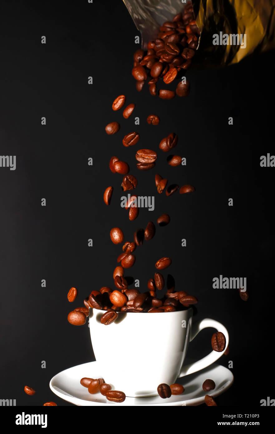 Espresso beans and espresso cup - Stock Image