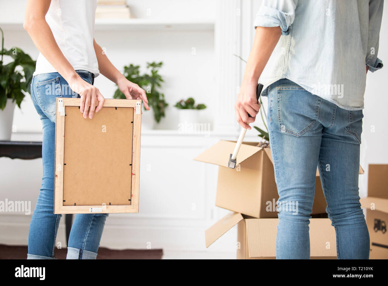 Close-up of couple furnishing new home - Stock Image