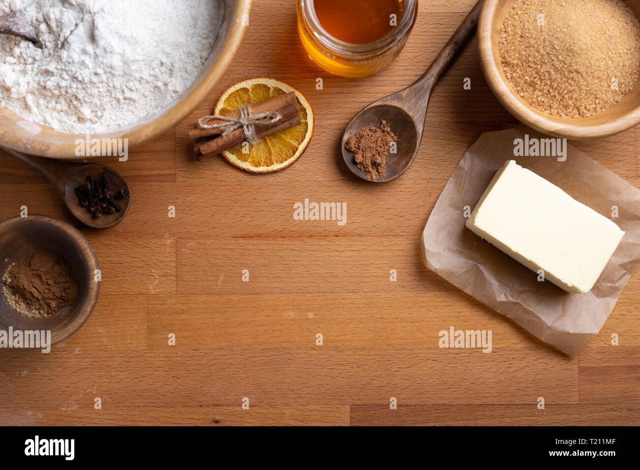 Top view of food ingredients with copy space for recipe. Flour, butter, sugar, spices. new year concept. - Stock Image