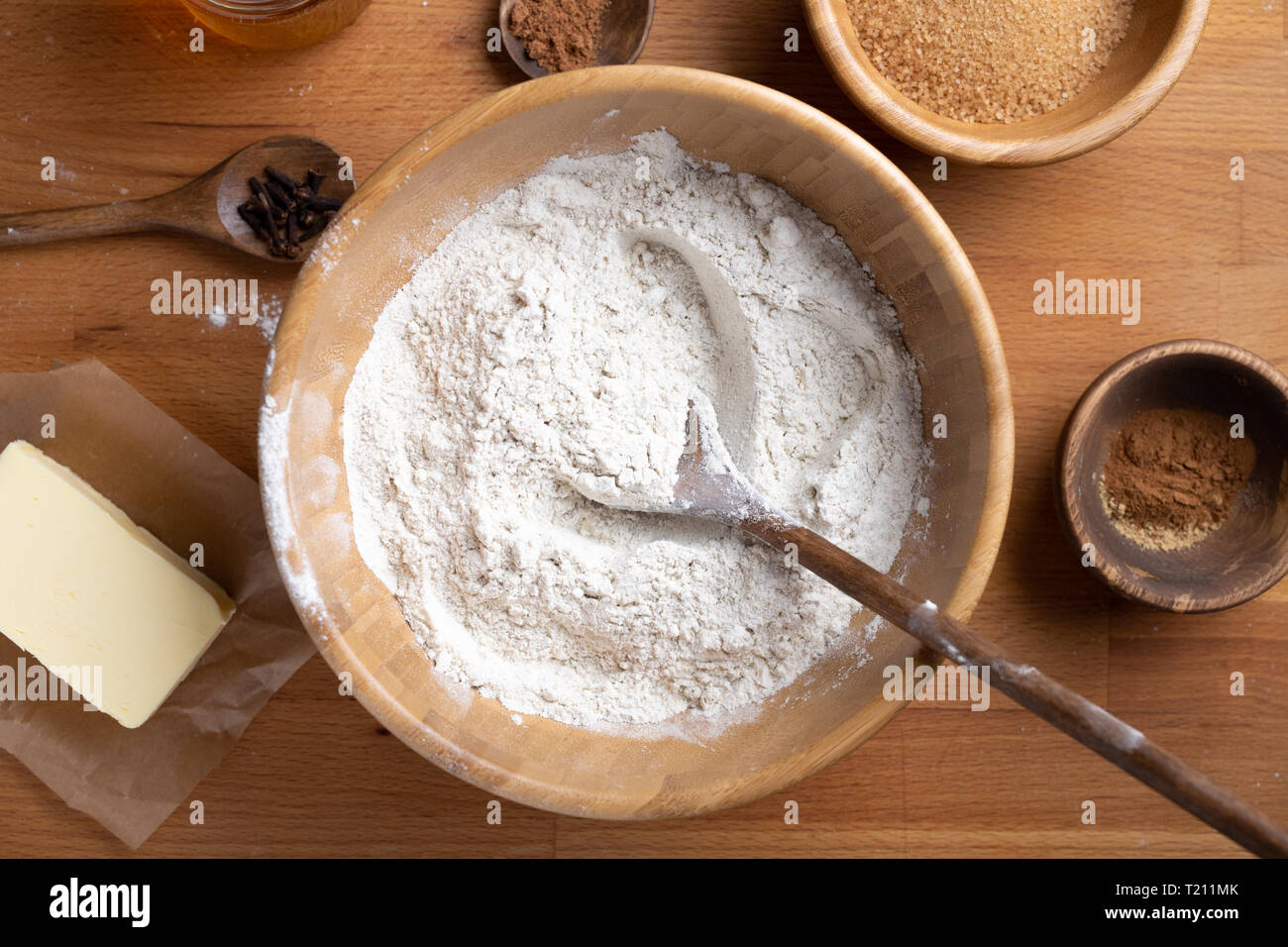 Top view of food ingredients with big bowl of flour in the middle new year concept. - Stock Image