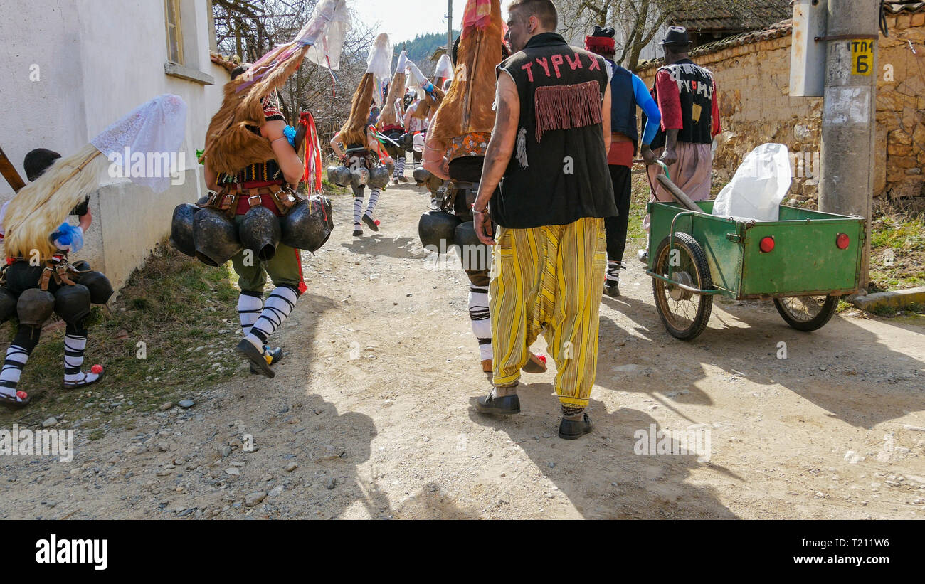 Turia, Bulgaria, 9 March 2019. Masquerade ritual Kukeri  to expel evil.  People from the village wear big bells and terrible costumes. Stock Photo