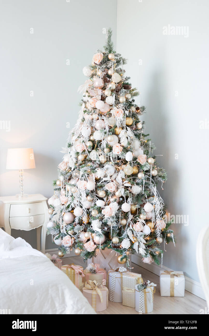 Christmas Tree With White And Light Pink Blue Balls And Gift Boxes Over Wall New Year Christmas Concept Decoration Stock Photo Alamy
