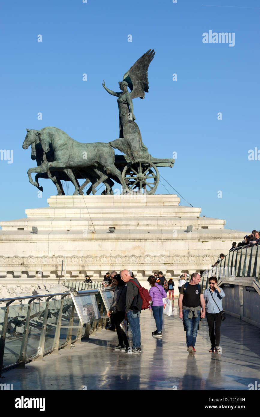 Tourists Enjoy Panoramic Views over the Rooftops of Rome from the Vittorio Emanuele II Monument with Winged Victory Sculpture Rome Italy Stock Photo