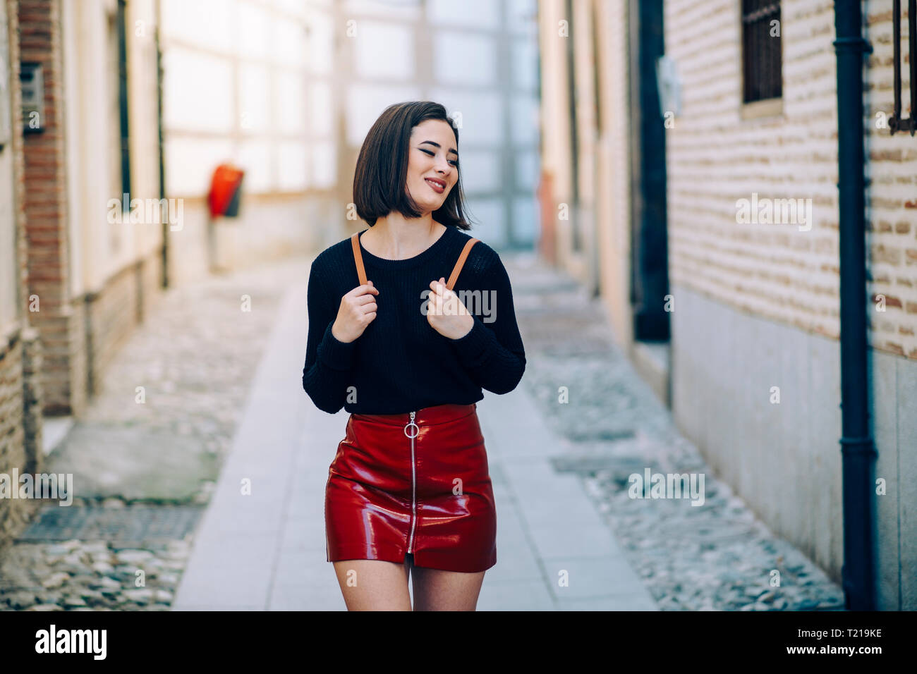 9ea1d75fe Portrait of young woman wearing red patent leather skirt with zipper -  Stock Image