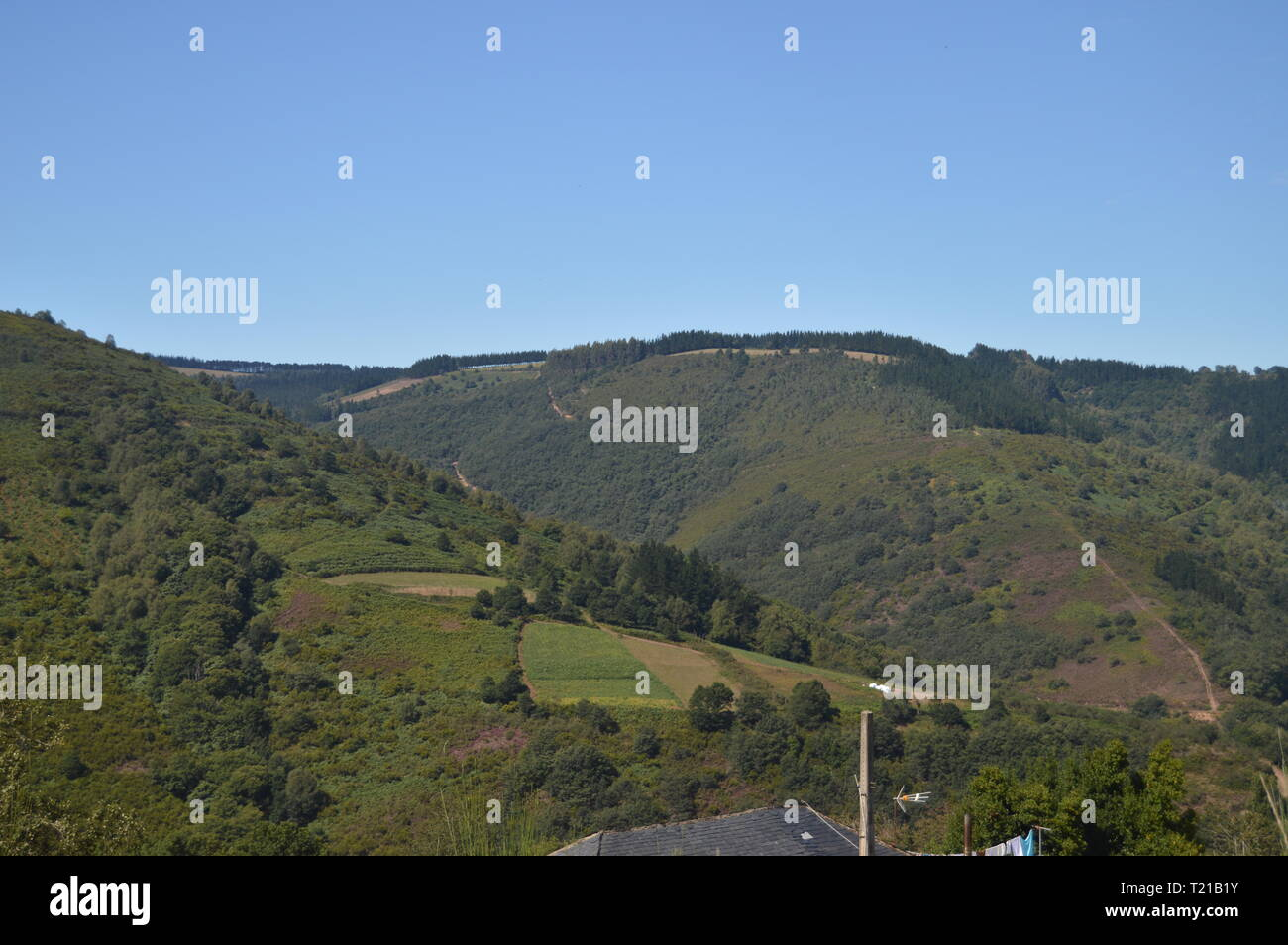 Magnificent Views Of The Mountains Of Galicia Delimiting With Asturias In Rebedul. Nature, Architecture, History, Street Photography. August 24, 2014. - Stock Image