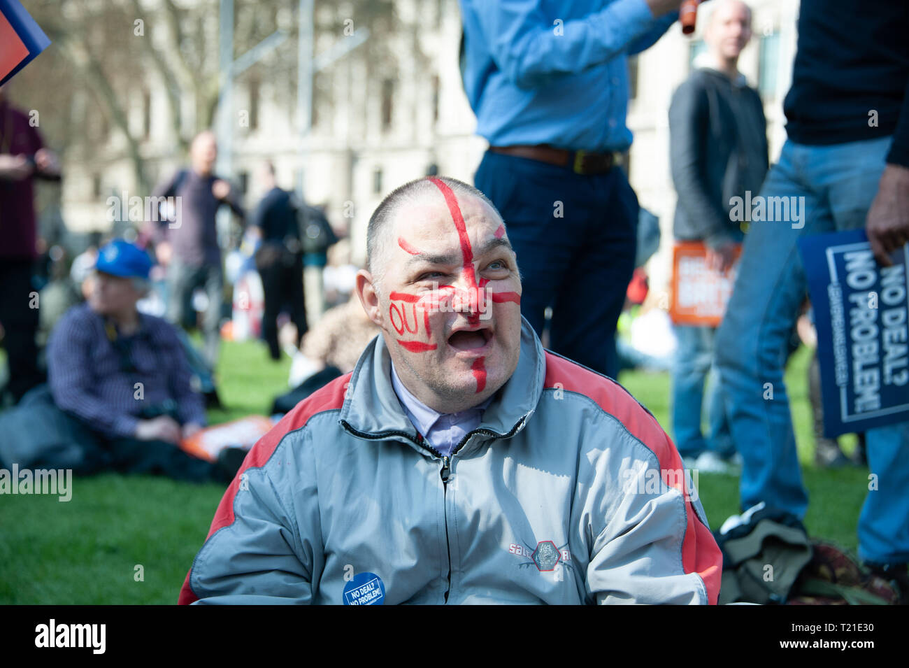 London, United Kingdom. 29th Mar, 2019. A Pro Leave protestor with painted Pro Leave face during a rally near Parliament Square. Credit: Sandip Savasadia/Alamy Live News - Stock Image