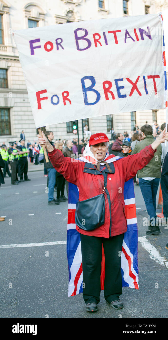 Pro Brexit March 29/3/2019 Protester Holding for Britain for Brexit Banner outside Houses of Parliament, Westminster, Central London, UK Stock Photo