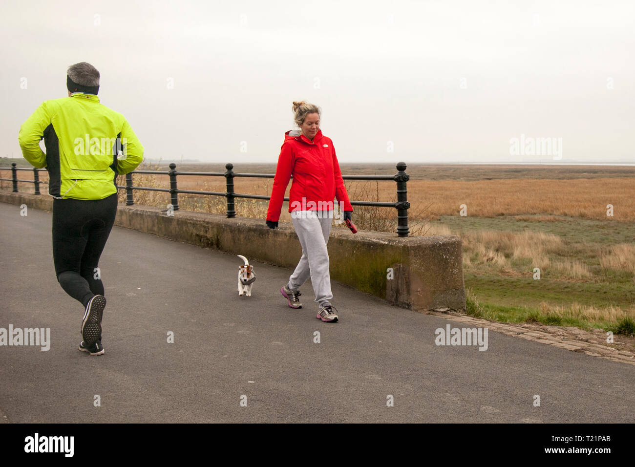 Lytham Saint Annes, Lancashire. 30th March, 2019. UK Weather. Bright outfits on a dull overcast day. Credit. MWI/AlamyLiveNews Credit: MediaWorldImages/Alamy Live News - Stock Image