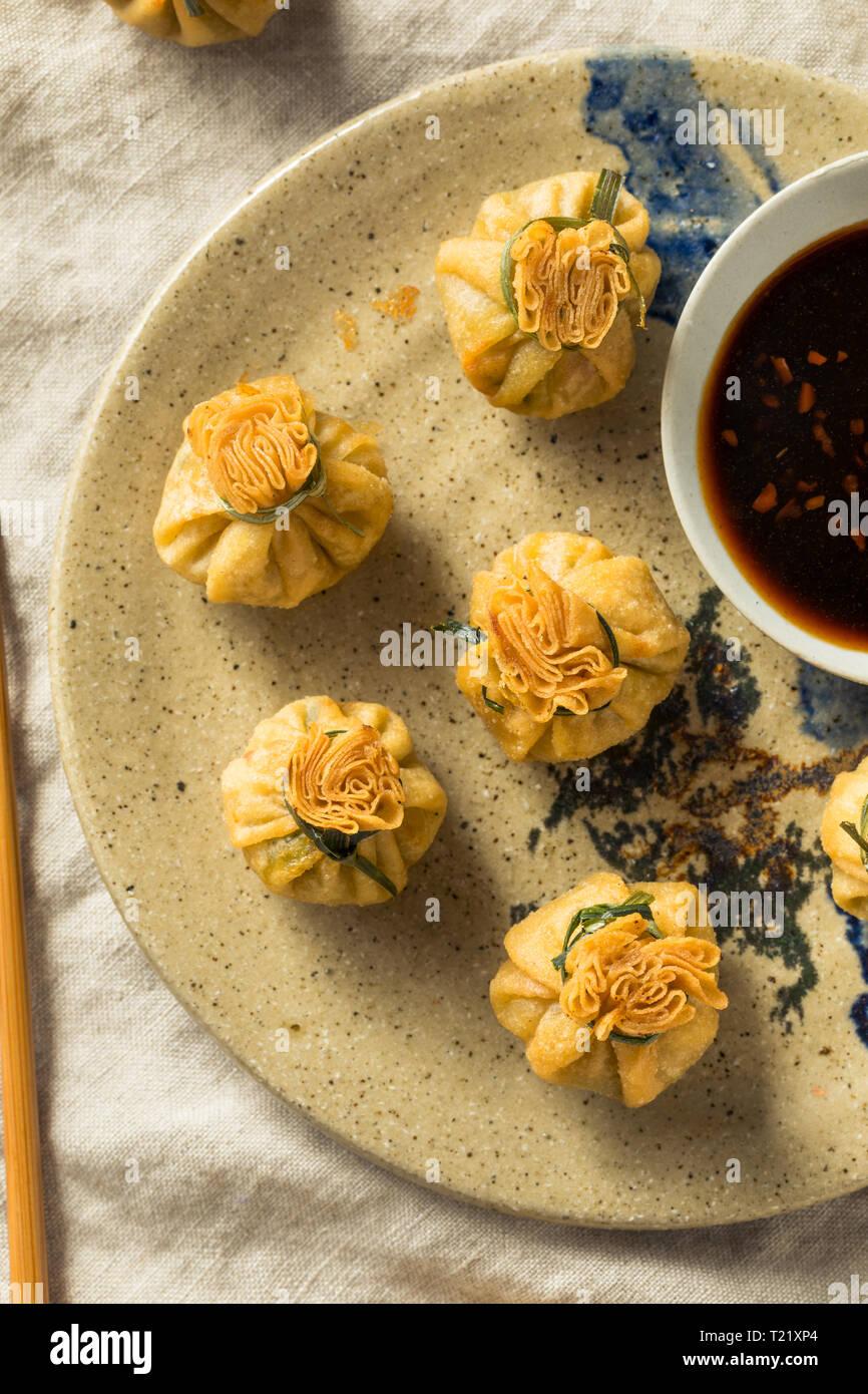 Homemade Deep Fried Shrimp Purse Dumplings with Soy Sauce Stock Photo