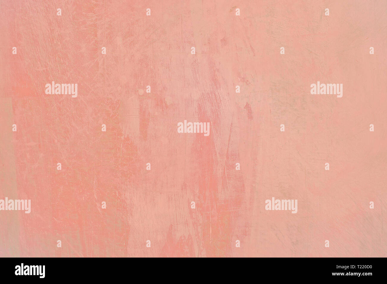 Grungy red roughcast wall scratchy background texture toned
