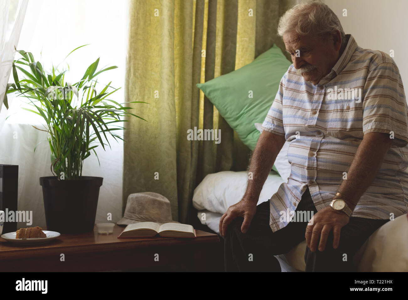 Sad Senior Man Sitting In A Room At Nursing Home Stock Photo Alamy