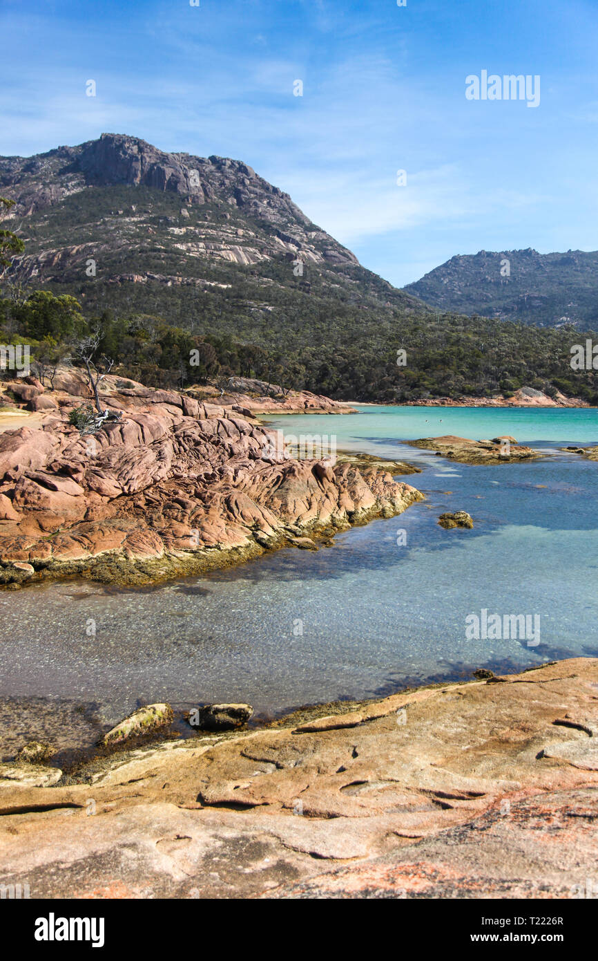 View across Honeymoon Bay Towards the 'Hazards' Mountain range. The area around Coles Bay has beautiful coast including the well known Wine Glass Bay. - Stock Image