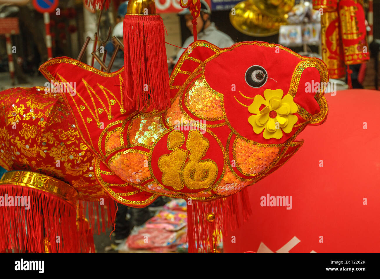 Red and gold carps on street market - decoration for celebrating Tet, Vietnamese new year in Hanoi, Vietnam. - Stock Image