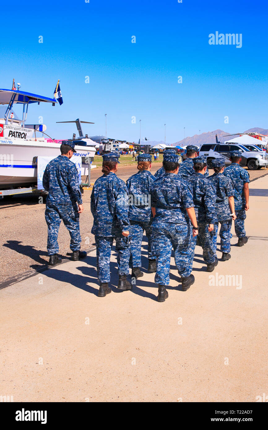 Sailors of the USCG in camouflage blue uniforms undergoing a drill exercise at the Davis-Monthan AFB airshow day in Tucson AZ - Stock Image