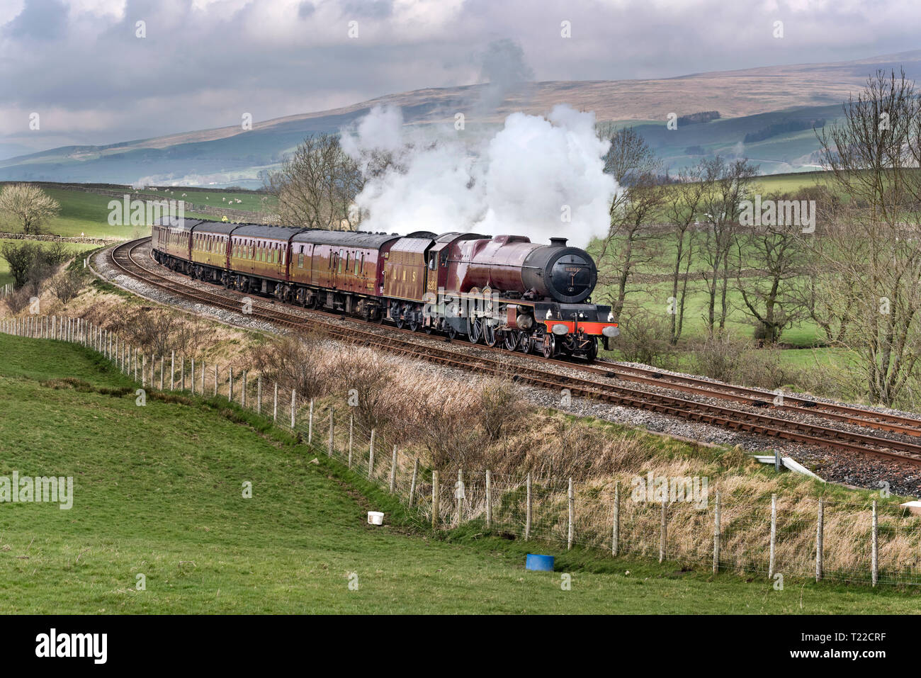 Princess Elizabeth a 1930s express steam locomotive on a test run, following restoration work, seen here on the mainline near Clapham, North Yorkshire - Stock Image