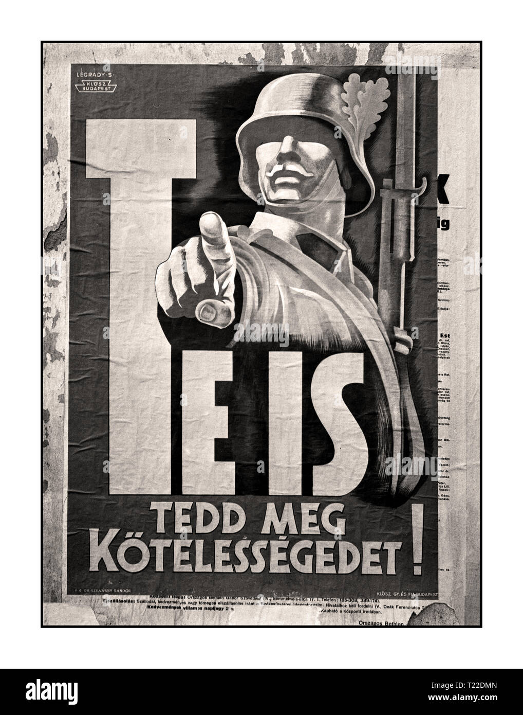 Vintage WW2 B&W Street Poster 'Comrade you can do it' 'You also do your duty!' Budapest 1940's recruitment poster, soldier, Sándor Légrády-graphics 1942 Hungary In 1940, under pressure from Nazi Germany, Hungary joined the Facist Axis powers. The following year, Hungarian forces participated in the invasion of Yugoslavia and the invasion of the Soviet Union. - Stock Image