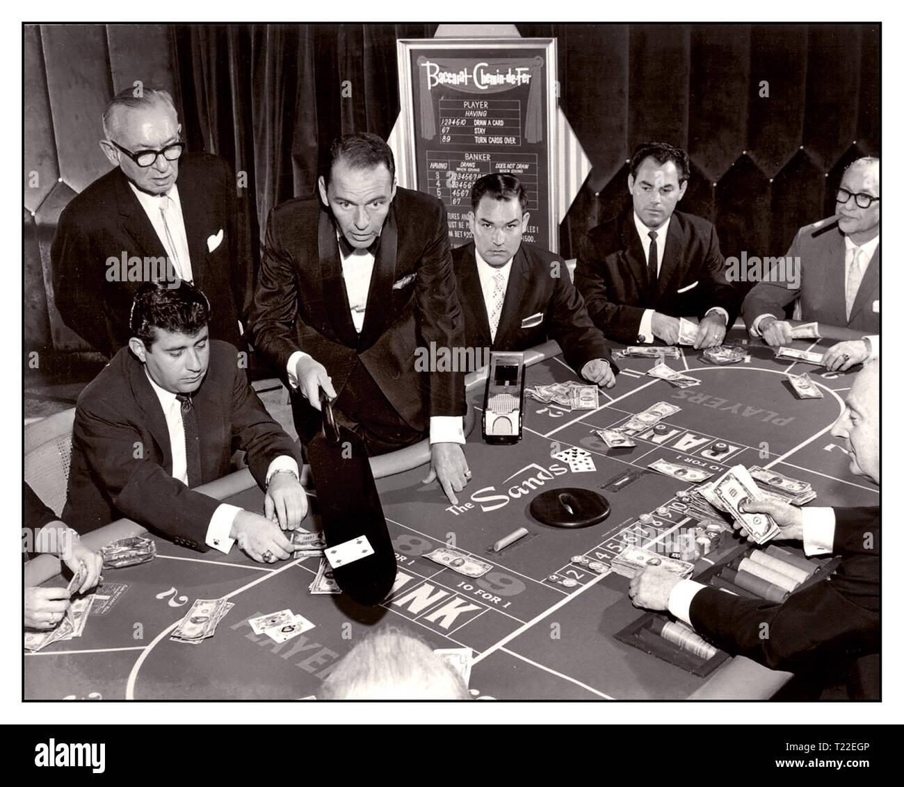 1950's Frank Sinatra in formal black tie dinner jacket, in gambling situation dealing baccarat in the Sands Casino, Las Vegas, November 1959 Sands Casino Las Vegas Nevada USA - Stock Image