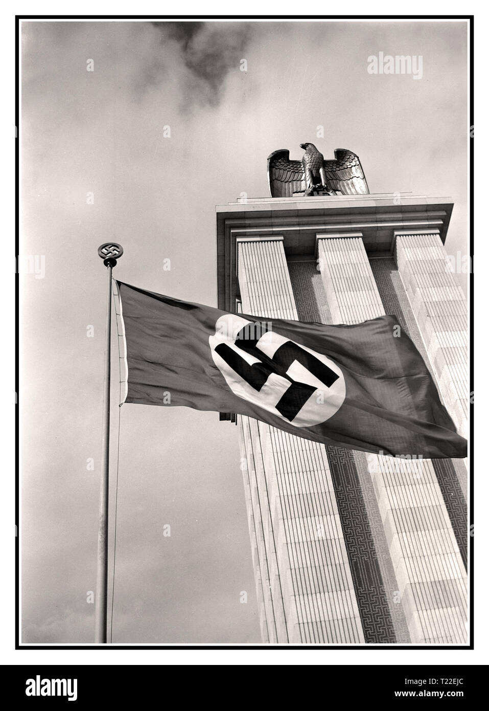 GERMANY 1937 World Exhibition Paris 1937 The German Pavilion with German eagle and Swastika Flag flying at the Paris World Exhibition France The Exposition Internationale des Arts et Techniques dans la Vie Moderne (International Exposition of Art and Technology in Modern Life) was held from 25 May to 25 November 1937 in Paris, France Albert Speer's pavilion was culminated by a tall tower crowned with the symbols of the Nazi state: an eagle and the swastika. The pavilion was conceived as a monument to 'German pride and achievement'. - Stock Image