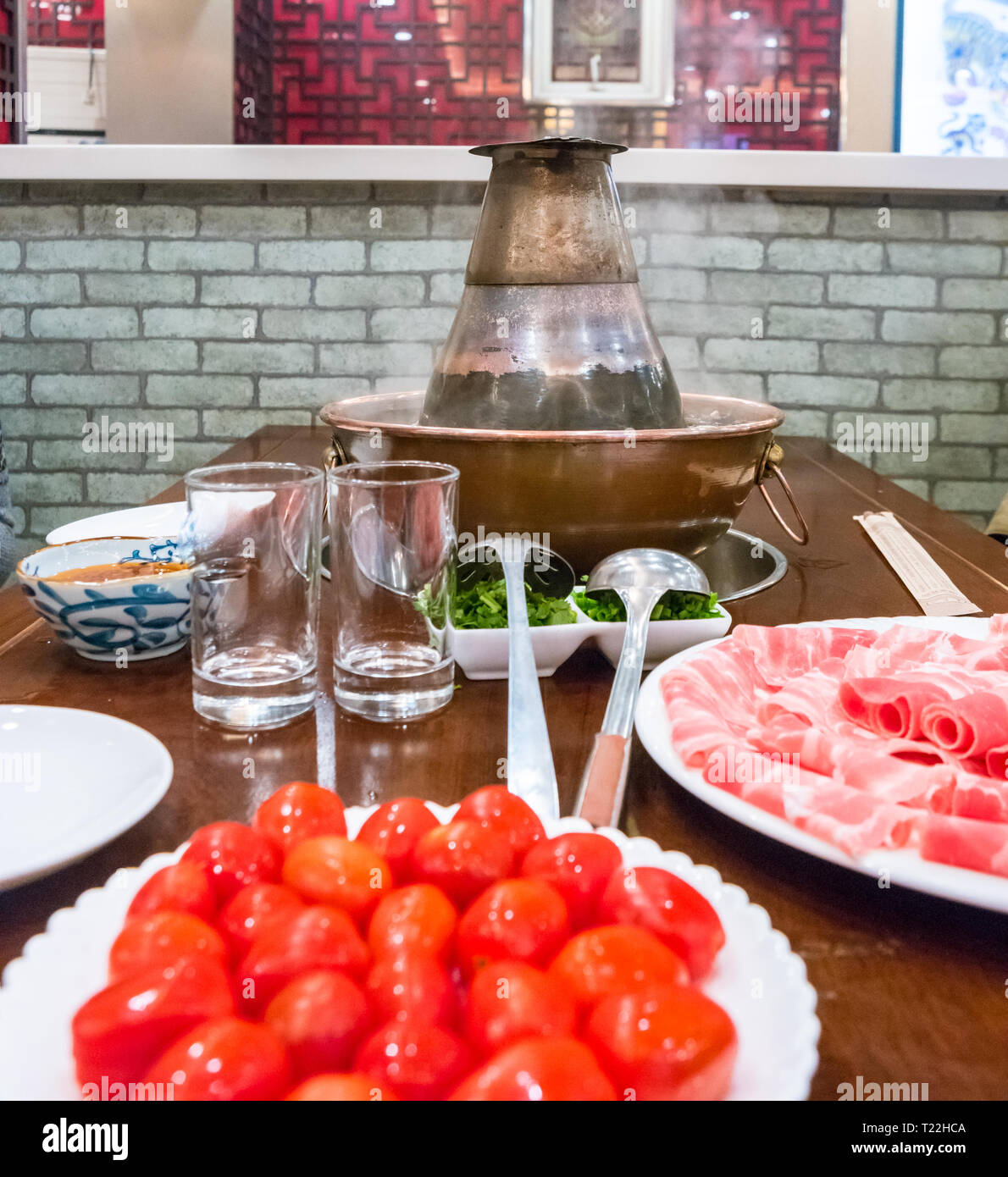 A traditional Chinese hotpot with meat and condiments. Food photography Stock Photo