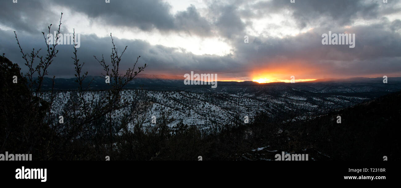 Sunset behind the a snowy Pinos Altos Range in Winter, Gila National Forest, near Silver City New Mexico Stock Photo