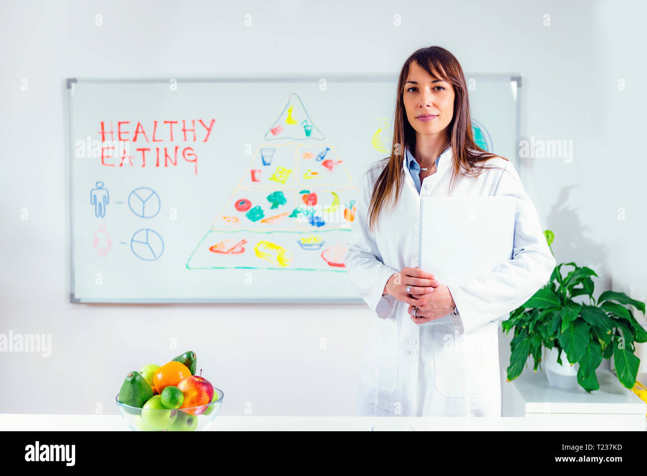 Portrait of a nutritionist. - Stock Image