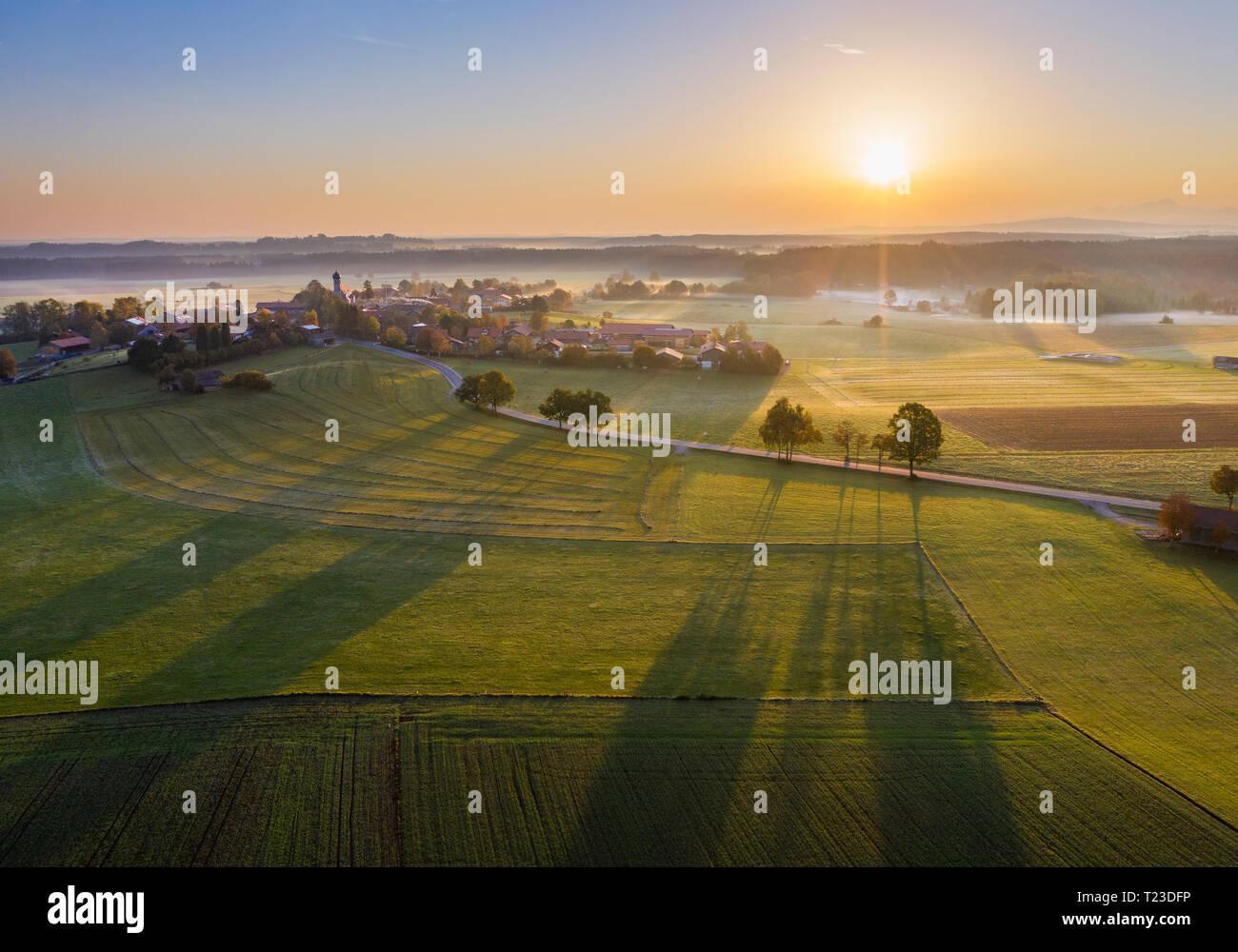 Germany, Bavaria, Lochen near Dietramszell, sunrise, drone view - Stock Image