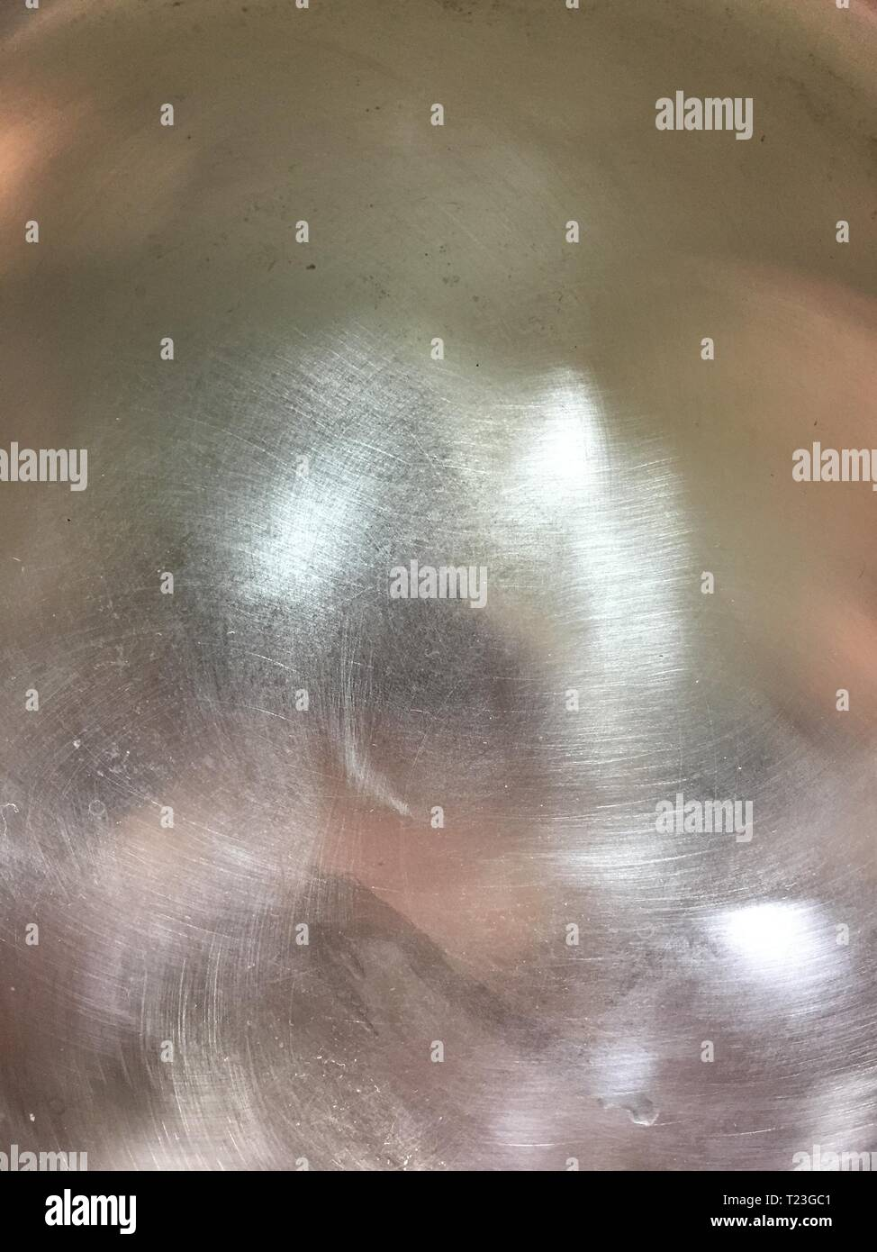 Stainless steel surface, bottom of a pot, clean, polished. - Stock Image