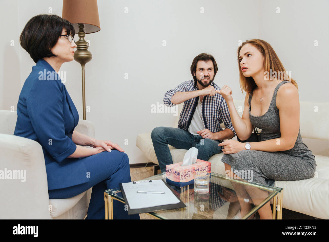 Mad guy is looking at his wife He threatens her  Young woman