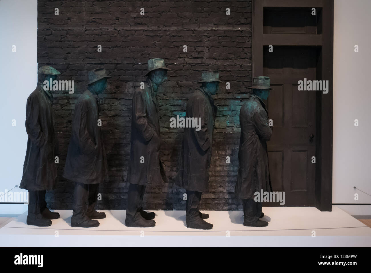 five figure represents americans waiting in line for assistance during the great US depression from 1929 to 1939, art work done by george segal, named - Stock Image