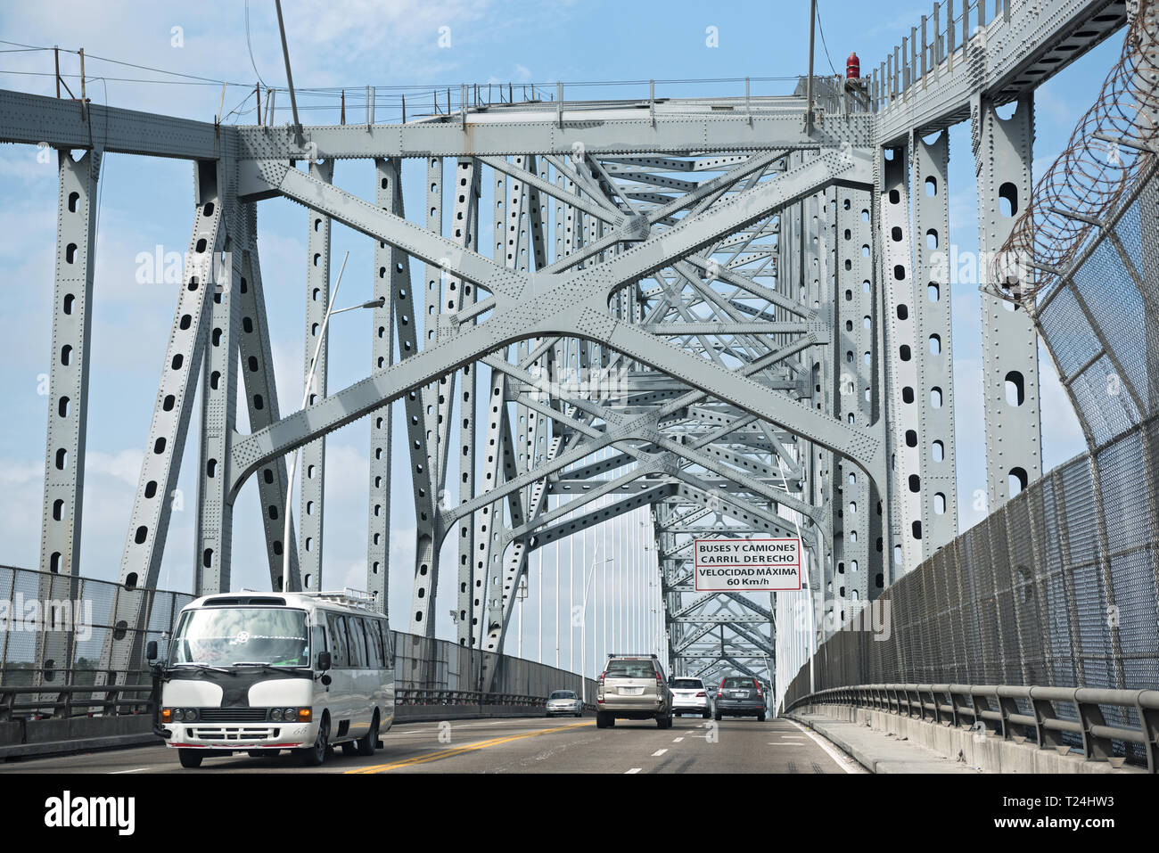 road traffic on the bridge of the americas entrance to the panama canal in the west of panama city panama - Stock Image