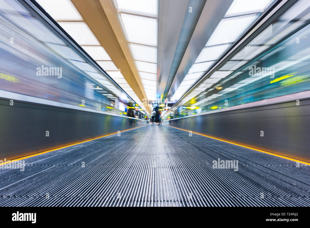 Moving walkway or travelator with motion blur at international airport - Stock Image